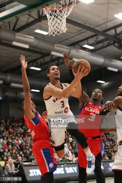 Nick Johnson of the Wisconsin Herd lays up against Angelo Delgado of the Agua Caliente Clippers during the G League game at the Menominee Nation...