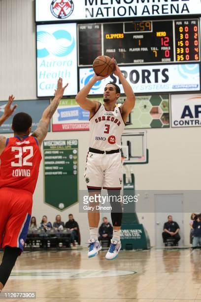 Nick Johnson of the Wisconsin Herd shoots against Marc Loving of the Agua Caliente Clippers during the G League game at the Menominee Nation Arena on...
