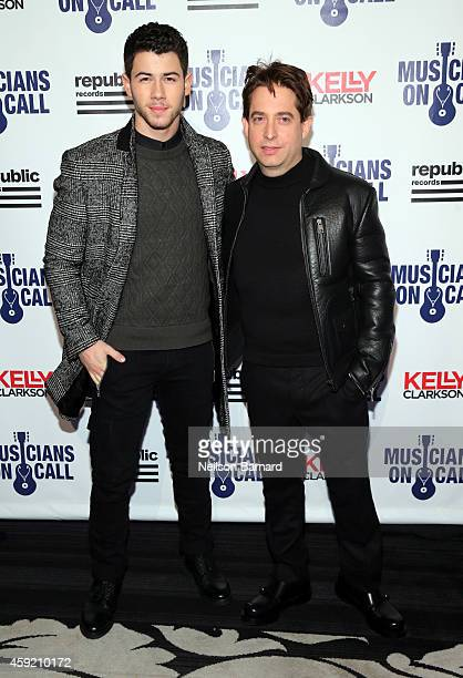 Nick Jonas and Executive Vice President Of Republic Records, Charlie Walk attend Musicians On Call Celebrates Its 15th Anniversary Honoring Kelly...