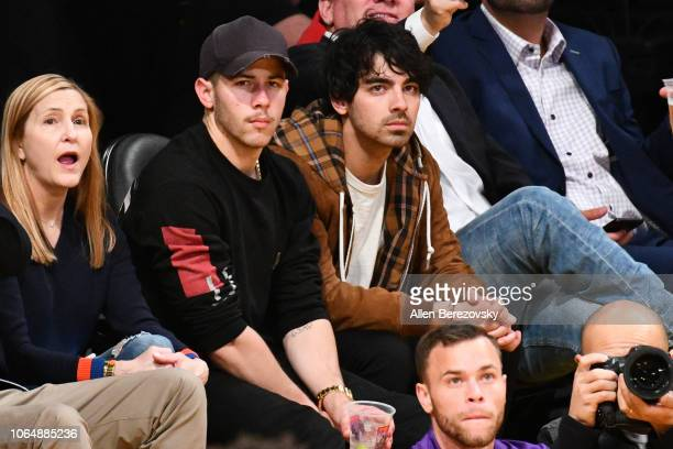Nick Jonas and Joe Jonas attend a basketball game between the Los Angeles Lakers and and the Minnesota Timberwolves at Staples Center on November 07...
