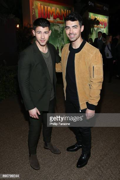 Nick Jonas and Joe Jonas attend the premiere of Columbia Pictures' Jumanji Welcome To The Jungle on December 11 2017 in Hollywood California