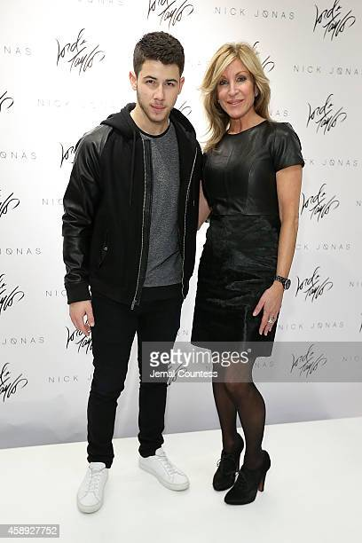 Nick Jonas and Karyn Benvenuto appear at the Lord Taylor annual holiday windows unveiling on November 13 2014 in New York City