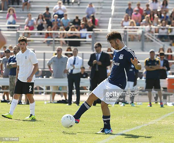 Nick Jonas and Kevin Jonas play soccer on the field at The Jonas Brothers host a charity soccer match held at StubHub Center - track and field on...