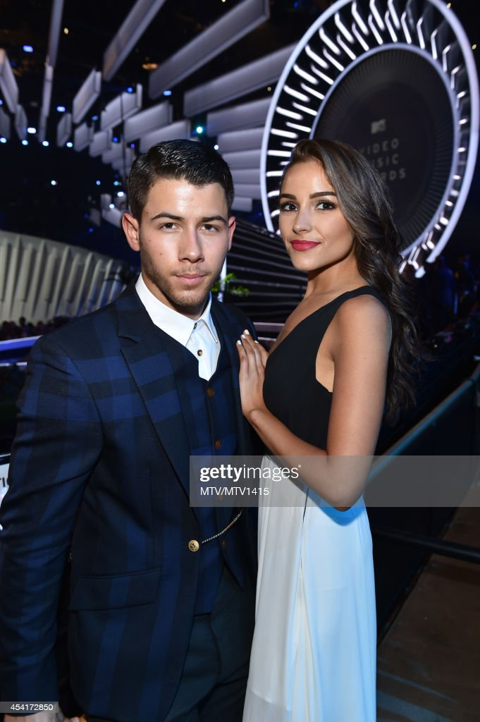 Nick Jonas and Olivia Culpo attend the 2014 MTV Video Music Awards at The Forum on August 24, 2014 in Inglewood, California.