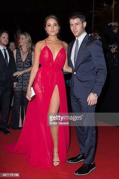 Nick Jonas and Olivia Culpo attend the opening red carpet party MIPCOM 2014 at Hotel Martinez on October 13, 2014 in Cannes, France.