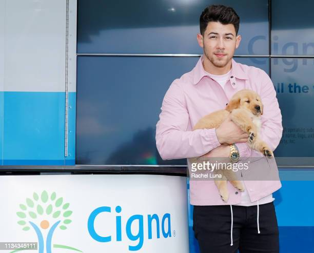 Nick Jonas and puppy costar appear at Cigna's Health Improvement Tour at Evolve on March 07 2019 in Los Angeles California