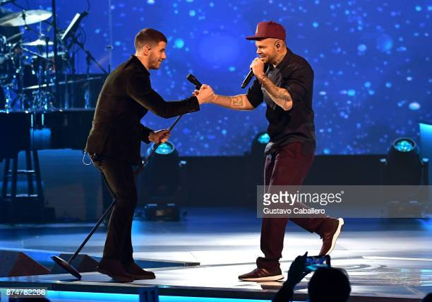 Nick Jonas and Residente perform onstage during the 2017 Person of the Year Gala honoring Alejandro Sanz at the Mandalay Bay Convention Center on...
