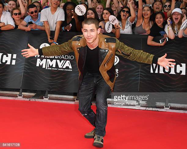 Nick Jonas arrives at the 2016 iHeartRADIO MuchMusic Video Awards at MuchMusic HQ on June 19 2016 in Toronto Canada
