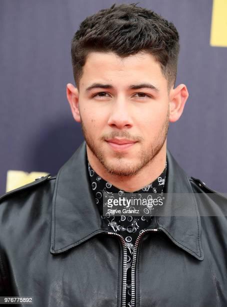 Nick Jonas arrives at the 2018 MTV Movie And TV Awards at Barker Hangar on June 16 2018 in Santa Monica California