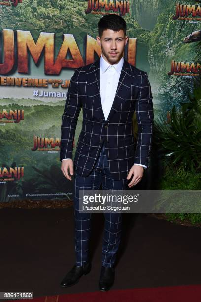 Nick Jonas attends Jumanji Welcome to the Jungle Premiere at Le Grand Rex on December 5 2017 in Paris France