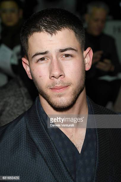 Nick Jonas attends the Emporio Armani show during Milan Men's Fashion Week Fall/Winter 2017/18 on January 14 2017 in Milan Italy