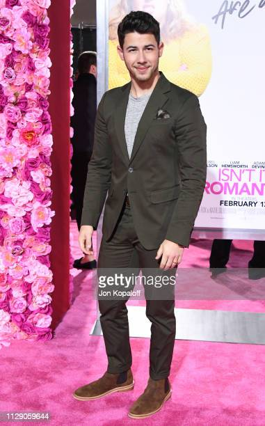 "Nick Jonas attends the premiere of Warner Bros. Pictures' ""Isn't It Romantic"" at The Theatre at Ace Hotel on February 11, 2019 in Los Angeles,..."
