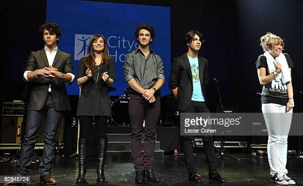 UNIVERSAL CITY CA SEPTEMBER 14 Nick Jonas Demi Lovato Kevin Jonas Joe Jonas and Miley Cyrus attend the City of Hope Benefit Concert with Miley Cyrus...