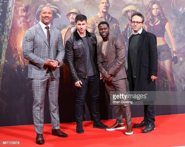 Nick Jonas Dwayne Johnson and Kevin Hart arrive at the German premiere of 'Jumanji Willkommen im Dschungel' at Sony Centre on December 6 2017 in...