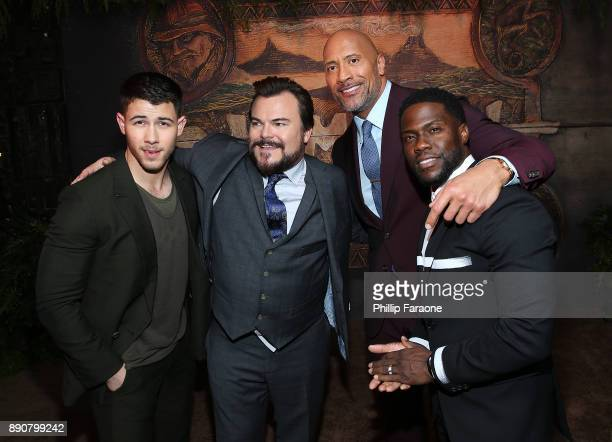 Nick Jonas Jack Black Dwayne Johnson and Kevin Hart attend the premiere of Columbia Pictures' Jumanji Welcome To The Jungle on December 11 2017 in...