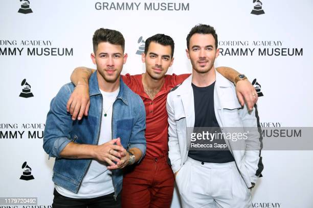 Nick Jonas Joe Jonas and Kevin Jonas attend An Evening With The Jonas Brothers at the GRAMMY Museum on October 07 2019 in Los Angeles California