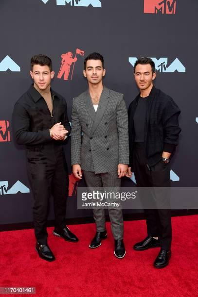 Nick Jonas Joe Jonas and Kevin Jonas attend the 2019 MTV Video Music Awards at Prudential Center on August 26 2019 in Newark New Jersey