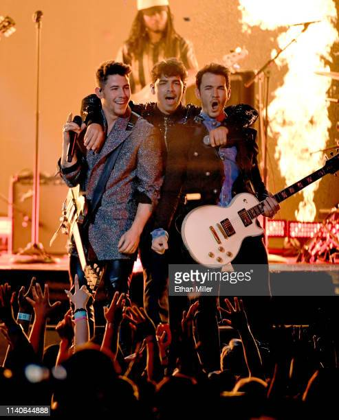 Nick Jonas Joe Jonas and Kevin Jonas of Jonas Brothers perform onstage during the 2019 Billboard Music Awards at MGM Grand Garden Arena on May 1 2019...