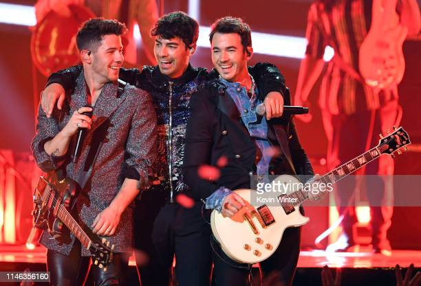 Nick Jonas Joe Jonas and Kevin Jonas of Jonas Brothers perform onstage during the 2019 Billboard Music Awards at MGM Grand Garden Arena on May 01...