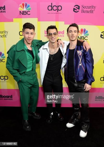 Nick Jonas, Joe Jonas, and Kevin Jonas of Jonas Brothers pose backstage for the 2021 Billboard Music Awards, broadcast on May 23, 2021 at Microsoft...