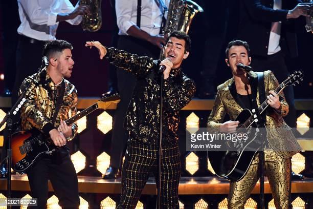 Nick Jonas Joe Jonas and Kevin Jonas of music group Jonas Brothers perform onstage during the 62nd Annual GRAMMY Awards at STAPLES Center on January...