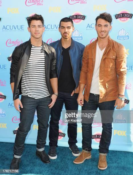 Nick Jonas Joe Jonas and Kevin Jonas of the Jonas Brothers arrive at the 2013 Teen Choice Awards at Gibson Amphitheatre on August 11 2013 in...