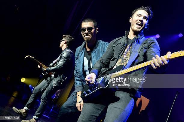 Nick Jonas Joe Jonas and Kevin Jonas of the Jonas Brothers at Gibson Amphitheatre on August 16 2013 in Universal City California