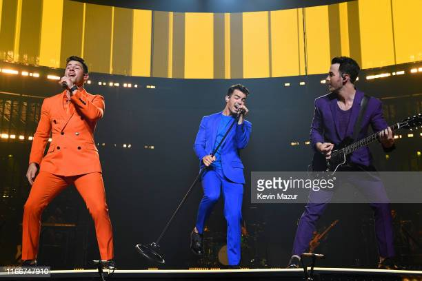 Nick Jonas Joe Jonas and Kevin Jonas of The Jonas Brothers perform on stage during their Happiness Begins Tour Opener at American Airlines Arena on...