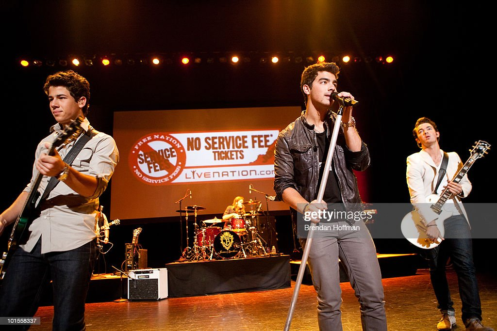 Nick Jonas, Joe Jonas, and Kevin Jonas of the Jonas Brothers perform for the Live Nation NSF Event at the Warner Theatre on June 2, 2010 in Washington, DC.