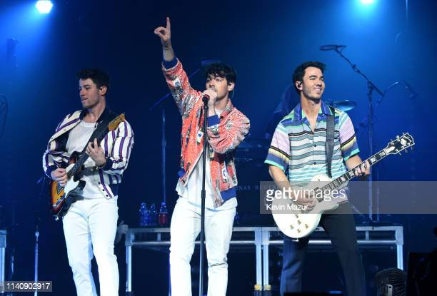 Nick Jonas Joe Jonas and Kevin Jonas of the Jonas Brothers perform onstage at the March Madness Music Series featuring Jonas Brothers presented by...