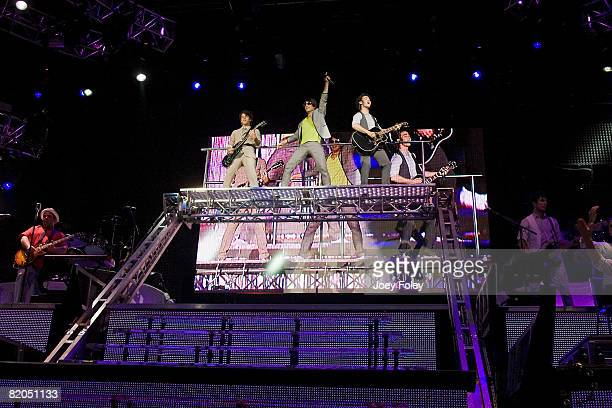 Nick Jonas Joe Jonas and Kevin Jonas of the Jonas Brothers perform live in concert at the Verizon Wireless Music Center on July 23 2008 in...
