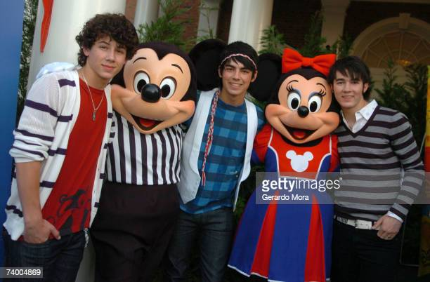 Nick Jonas Joe Jonas and Kevin Jonas of the Jonas Brothers pose with Disney characters Mickey and Minnie Mouse before the Disney Channel Games 2007...