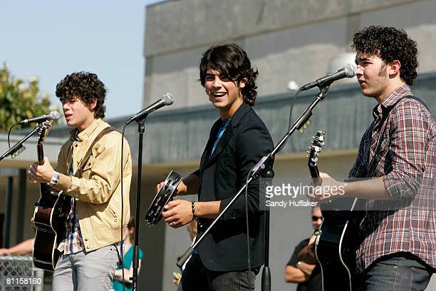 Nick Jonas Joe Jonas and Kevin Jonas of The Jonas Brothers sing as part of the Topps Baby Bottle Pop School Concert Invasion for students at Adobe...