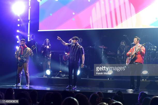 Nick Jonas Joe Jonas and Kevin Jonas of The Jonas Brothers speak onstage during the The CW Network 2019 Upfronts at New York City Center on May 16...