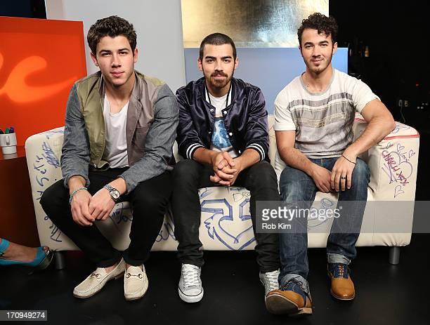 Nick Jonas Joe Jonas and Kevin Jonas of the Jonas Brothers visit Music Choice's UA at Music Choice on June 20 2013 in New York City