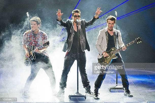"""Nick Jonas, Joe Jonas and Kevin Jonas perform during the """"Jonas Brothers Live In Concert"""" tour opener at the First Midwest Bank Amphitheatre on..."""