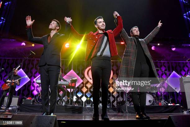 Nick Jonas, Joe Jonas and Kevin Jonas perform onstage during iHeartRadio's Z100 Jingle Ball 2019 Presented By Capital One on December 13, 2019 in New...