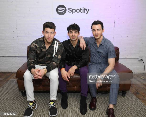 Nick Jonas Joe Jonas and Kevin Jonas pose for a photo as Spotify Hosts A Carnival Of Happiness For The Jonas Brothers And Their Top Listeners To...