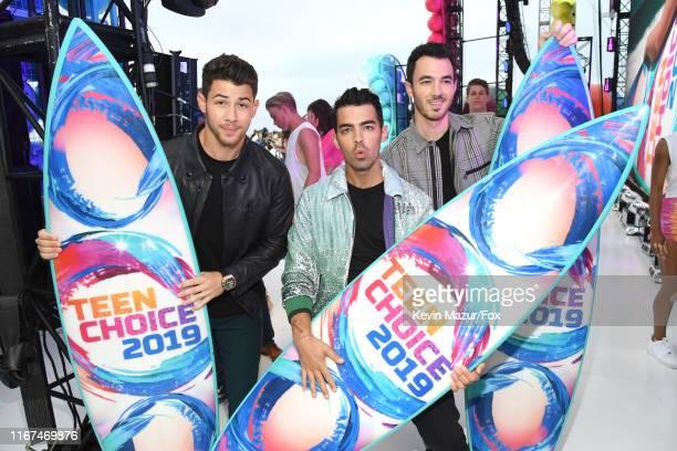 Nick Jonas Joe Jonas and Kevin Jonas winners of the Teen Choice Decade Award attend FOX's Teen Choice Awards 2019 on August 11 2019 in Hermosa Beach...