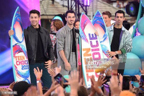 Nick Jonas, Kevin Jonas, and Joe Jonas accept the Teen Choice Decade Award onstage during FOX's Teen Choice Awards 2019 on August 11, 2019 in Hermosa...