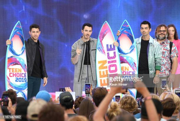 Nick Jonas Kevin Jonas and Joe Jonas of Jonas Brothers accept the Teen Choice Decade Award onstage during FOX's Teen Choice Awards 2019 on August 11...