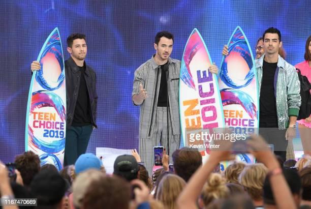 Nick Jonas, Kevin Jonas and Joe Jonas of Jonas Brothers accept the Teen Choice Decade Award onstage during FOX's Teen Choice Awards 2019 on August...