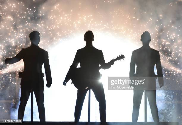 """Nick Jonas, Kevin Jonas, and Joe Jonas of Jonas Brothers perform in support of the band's """"Happiness Begins"""" tour at Chase Center on October 08, 2019..."""