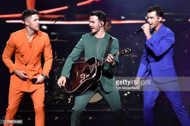 Nick Jonas Kevin Jonas and Joe Jonas of Jonas Brothers perform in support of the band's Happiness Begins tour at Chase Center on October 08 2019 in...