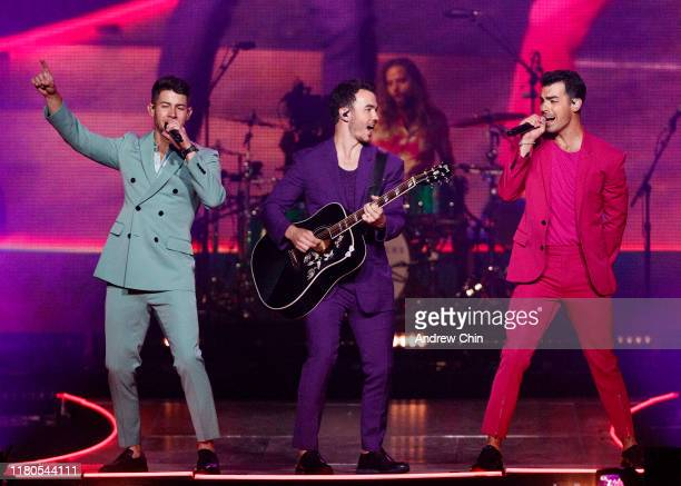 Nick Jonas, Kevin Jonas and Joe Jonas of the Jonas Brothers perform on stage at Rogers Arena on October 11, 2019 in Vancouver, Canada.