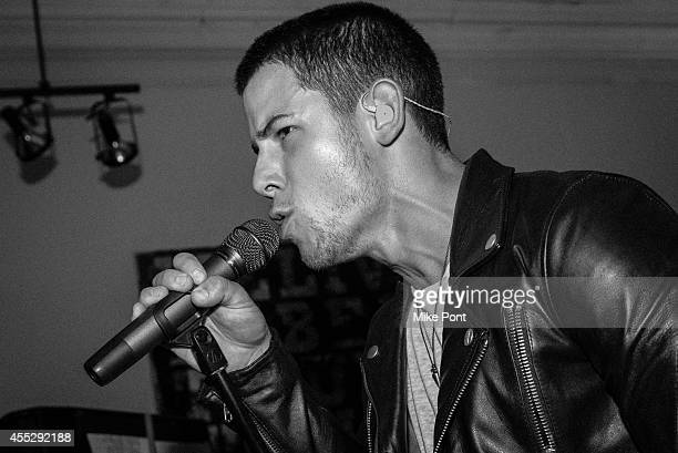 Nick Jonas performs a live pop up performance at Peter Tunney Gallery on September 11 2014 in New York City