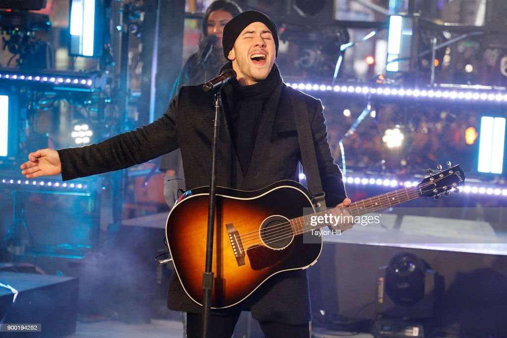 Nick Jonas performs during Dick Clark's New Year's Rockin' Eve at Times Square on December 31, 2017 in New York City.