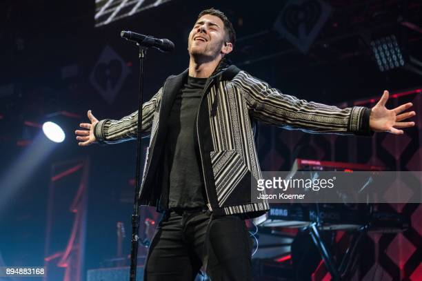 Nick Jonas performs on stage at the IHeartRadio Jingle Ball 2017 at BBT Center on December 17 2017 in Sunrise Florida