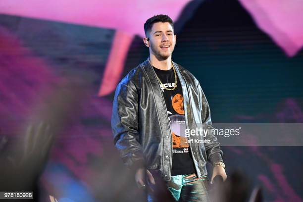 Nick Jonas performs onstage at the 2018 MTV Movie And TV Awards at Barker Hangar on June 16 2018 in Santa Monica California