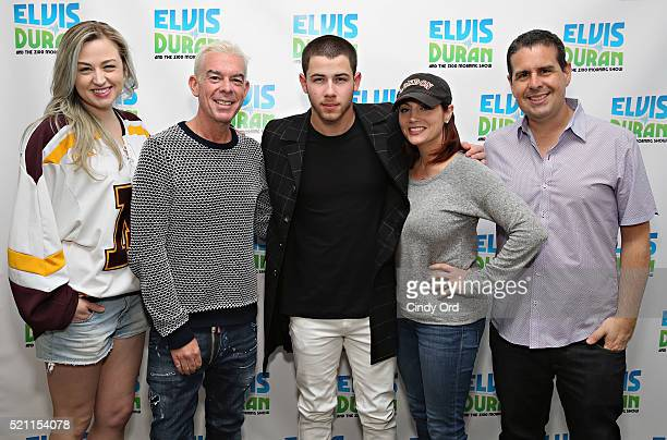 Nick Jonas poses for a photo with Bethany Watson Elvis Duran Danielle Monaro and Skeery Jone during a visit to The Elvis Duran Z100 Morning Show at...